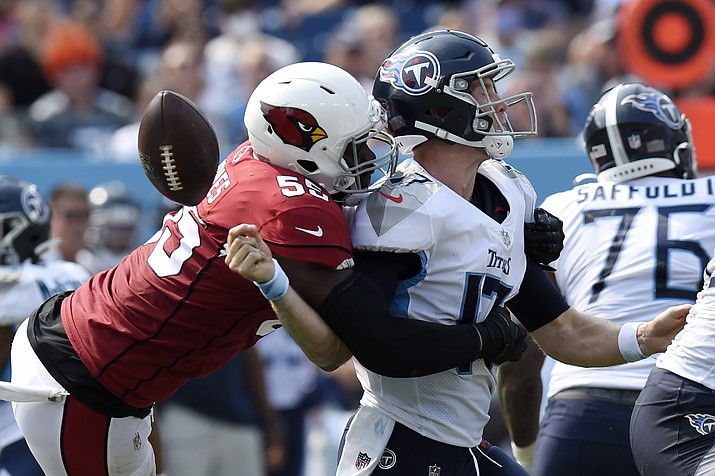 Arizona Cardinals linebacker Chandler Jones (55) sacks Tennessee Titans quarterback Ryan Tannehill (17) and forces a fumble that the Cardinals recovered in the second half of an NFL game Sunday, Sept. 12, 2021, in Nashville, Tenn. (Mark Zaleski/AP)