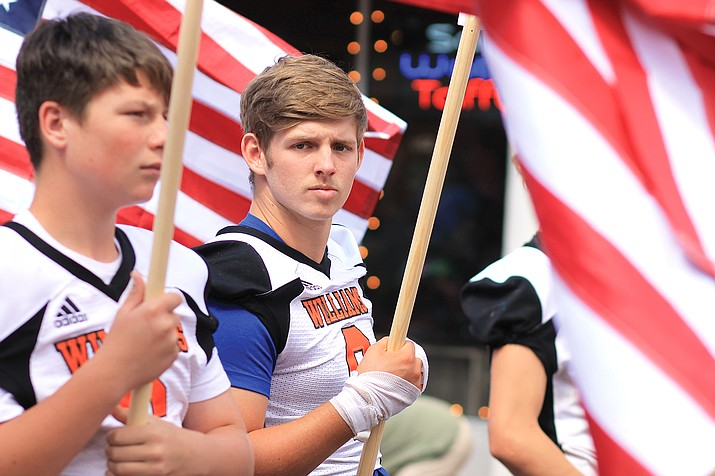 Williams High School student Danny Siegfried joins members of the Vikings football and cheer teams in the Sept. 11 Patriot Day Parade in Williams. (Wendy Howell/WGCN)