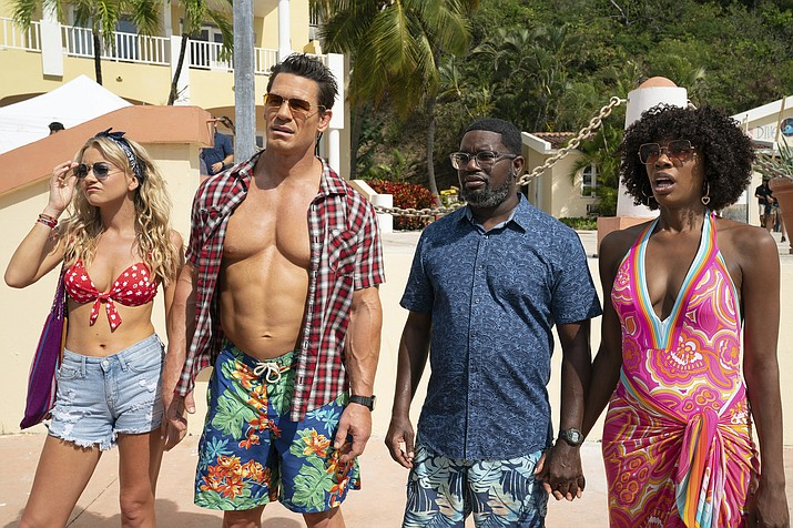 'Vacation Friends' starring Lil Rel Howery, John Cena, Yvonne Orji and Meredith Hagner is a 20th Century Studios release on Hulu Friday. (AP Photo)