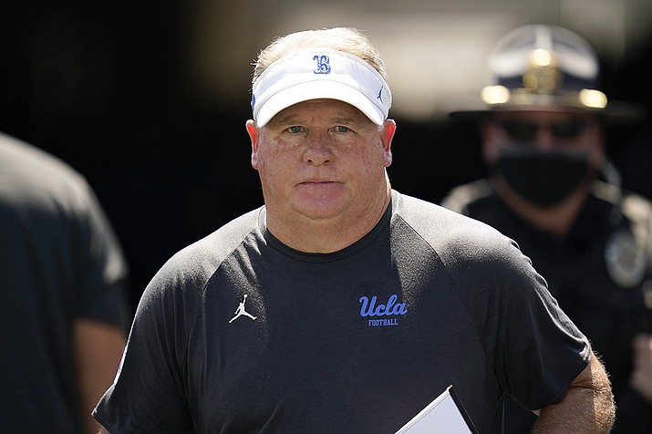 UCLA head coach Chip Kelly walks on to the field before an NCAA college football game against Hawaii Saturday, Aug. 28, 2021, in Pasadena, Calif. (Ashley Landis/AP)