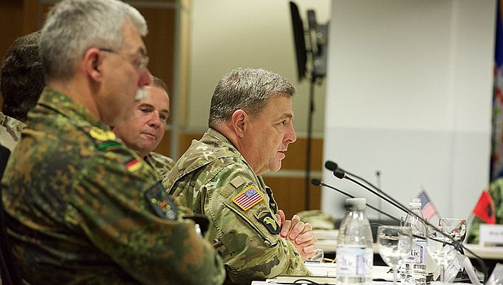 Excerpts from a forthcoming book reveal that Mark Milley, chairman of the Joint Chiefs of Staff, engaged in back-channel communications with his Chinese counterpart in the waning days of the Trump Administration to assure China that the two nations would not suddenly go to war. Milley, right, is pictured. (Photo by U.S. Army Europe Images, cc-by-sa-2.0, https://bit.ly/2XqgWr6)