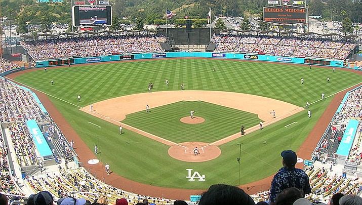 The Los Angeles Dodgers clinched a playoff berth by beating the Arizona Diamondbacks 8-4 on Tuesday, Sept. 14 in a Major League Baseball game played in Los Angeles. Dodger Stadium is pictured. (Photo by Frederick Dennstedt, cc-by-sa-2.0, https://bit.ly/2T35hMx)