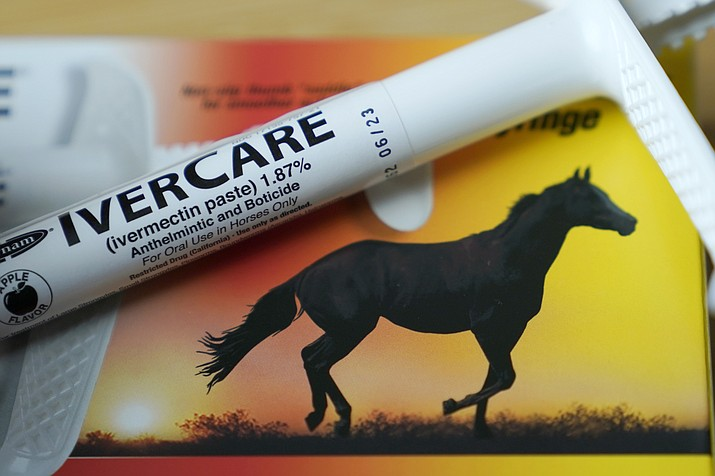 A syringe of ivermectin — a drug used to kill worms and other parasites — intended for use in horses only, rests on the box it was packaged in Sept. 10, 2021, in Olympia, Wash. Health experts and medical groups are pushing to stamp out the growing use of the parasite drug to treat COVID-19, warning that it can cause harmful side effects and that there's little evidence it helps. (Ted S. Warren/AP)