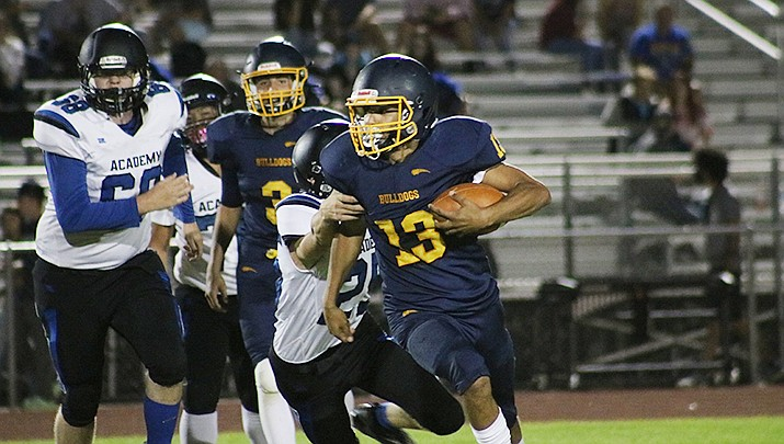 Malakai Bell of Kingman High School gained 202 yards last week in a win over Kingman Academy. The Bulldogs travel to Monument Valley to play the Mustangs on Friday, Sept. 17. (Photo by Travis Rains/Kingman Miner.)