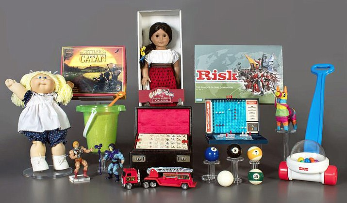 This photo provided by the National Toy Hall of Fame shows the finalists being considered for induction into the hall later this year. The finalists are: American Girl Dolls, Battleship, billiards, Cabbage Patch Kids, Fisher-Price Corn Popper, Mahjong, Masters of the Universe, piñata, Risk, sand, The Settlers of Catan, and toy fire engine. The winners will be chosen by a panel of experts and inducted on Nov. 4, 2021. (National Toy Hall of Fame via AP)