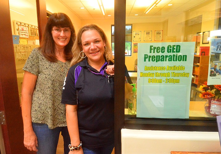 Alechea Mora, right and Kelly Roberts, Camp Verde adult reading program office manager, meet at the Camp Verde library on Tuesday, Sept. 14, 2021. (Vyto Starinskas/Independent)