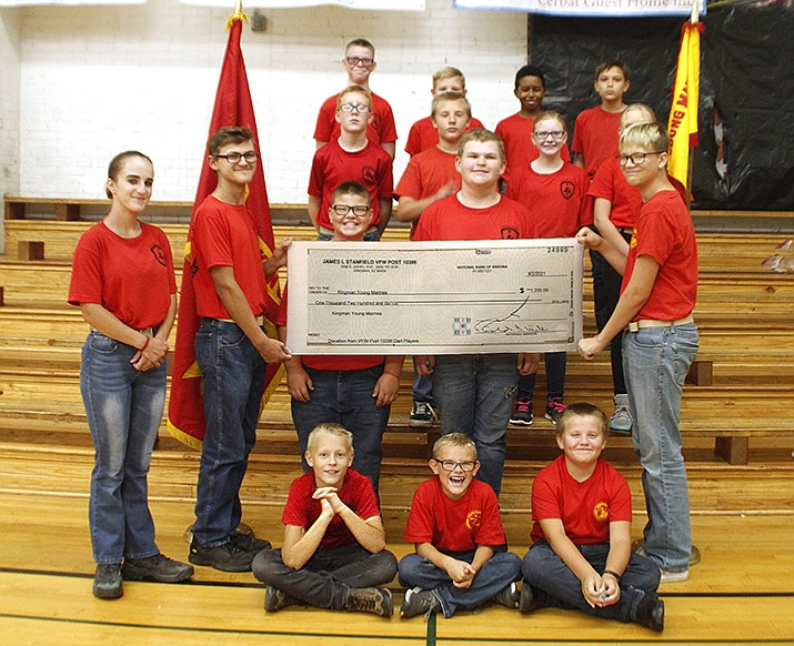 The VFW Dart Players League raised $1,200 to assist the Kingman Young Marines with the unit's various programs. (Courtesy photo)