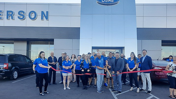The gang at Anderson Ford at 3601 Stockton Hill Road in Kingman cuts the ribbon during a grand reopening. (Courtesy photo)
