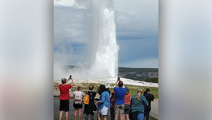 Visitors to Yellowstone National Park enjoy Old Faithful, one of the many geological phenomena caused by the Yellowstone hotspot. (Photo by Luis Vega/For the Miner)