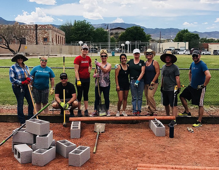 In this 2019 file photo, members of the Verde Valley Leadership group, Class XIII, pose during a project. VVL has partnered with Yavapai College and is now taking applications for the 2021-22 class. (VVL/Courtesy)