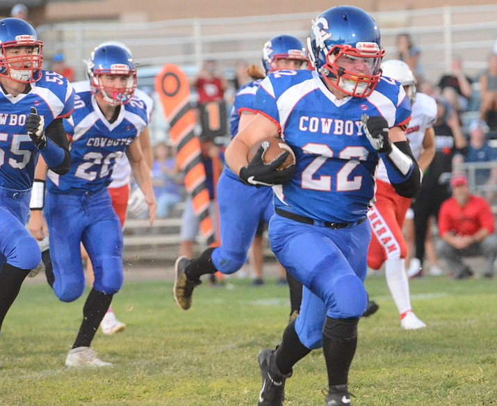 Kayden Boggess (22) runs with the football Aug. 27, 2021, in Camp Verde. Boggess had 213 yards rushing on 12 carries and three touchdowns in a 46-6 win over Heritage Academy on Friday, Sept. 17. (Vyto Starinskas/Independent, file)