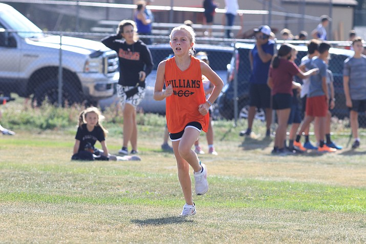 Lilyana Evans head to the finish line in the WEMS cross-country invitational Sept. 16. (Wendy Howell/WGCN)