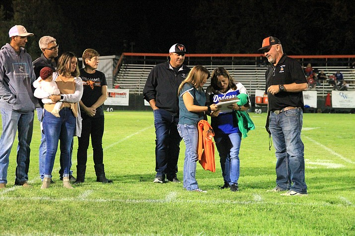 """Ernesto """"Ernie"""" Lugo Jr. was honored posthumously during the Sept. 17 high school football game in Williams. Family members, including nieces Angel and Cindy Aguilar, the Kevin and Jeanette Perkins family, and Keith Perkins accept a plaque from Williams High School Athletic Director Phillip Echeverria. Lugo was a big fan of the Williams Vikings and talking sports to whomever stood next to him. (Wendy Howell/WGCN)"""