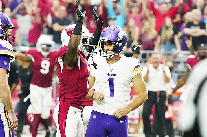 Arizona Cardinals strong safety Budda Baker celebrates after Minnesota Vikings kicker Greg Joseph (1) reacts to missing a game-winning field goal attempt during the second half of an NFL football game, Sunday, Sept. 19, 2021, in Glendale, Arizona. The Cardinals won 34-33. (Rick Scuteri/AP)