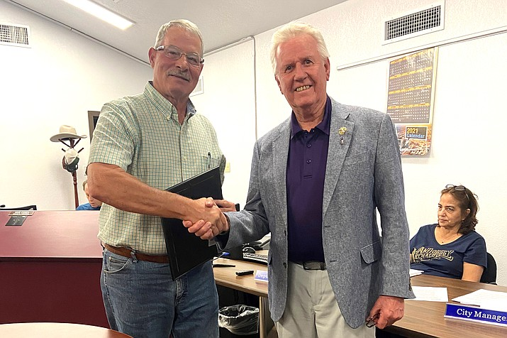 Williams Mayor John Moore and Vice Mayor Don Dent, pictured, were recognized by Rodger Ely for their efforts to help bring The Moving Wall, a 252-foot mobile replica of the Vietnam Memorial Wall in Washington D.C., to Williams June 4-6.
