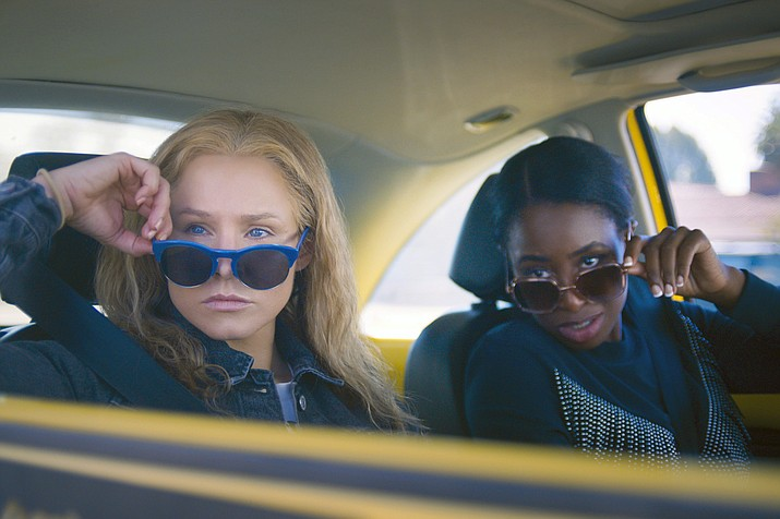 In 'Queenpins' a pair of housewives create a $40 million coupon scam. Starring Kristen Bell, Kirby Howell, Baptiste Paul and Walter Hauser. 'Queenpins,' is an STX Entertainment release, and has been rated R. (AP photo)