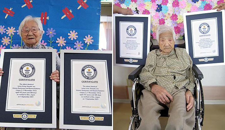 This combination of two undated photos, on Tuesday, Sept. 21, 2021, show sisters Umeno Sumiyama, left, and Koume Kodama at separate nursing homes in Shodoshima island, left, and Oita prefecture, Japan. The two Japanese twin sisters have been certified by Guinness World Records as the world's oldest living identical twins, aged 107 years and 300 days as of Sept. 1, 2021, the organization said Sept. 20, 2021. (Guinness World Records via AP)