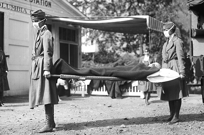 This photo made available by the Library of Congress shows a demonstration at the Red Cross Emergency Ambulance Station in Washington during the influenza pandemic of 1918. Historians think the pandemic started in the U.S. in Kansas in early 1918, and by winter 1919 the virus had infected a third of the global population and killed at least 50 million people, including 675,000 Americans. Some estimates put the toll as high as 100 million. (Library of Congress via AP, File)