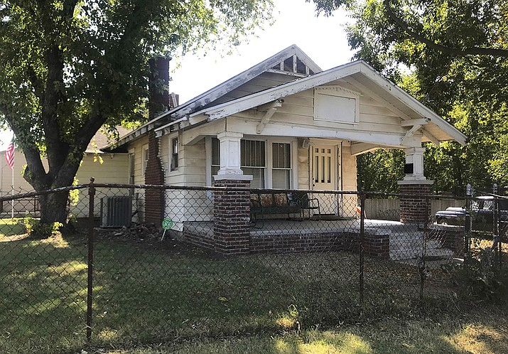 """The exterior of a home used for the 1983 film """"The Outsiders,"""" based on S.E. Hinton's classic 1967 novel, appears in Tulsa, Okla., Tuesday, Sept. 14, 2021. The home, which was purchased by rapper Danny Boy O'Connor, was converted into The Outsiders House Museum. (Kristi Eaton/AP)"""