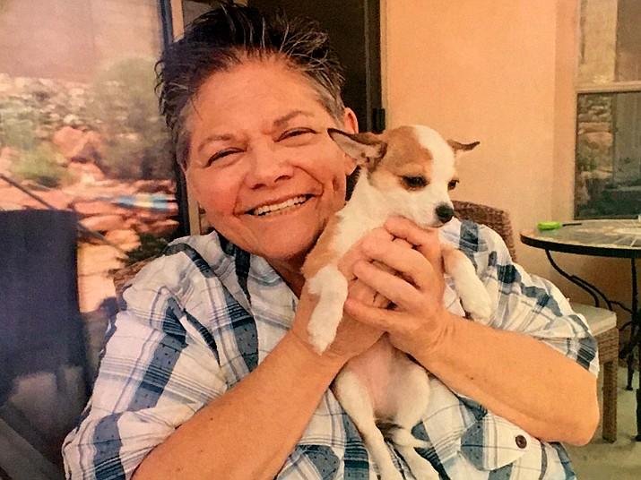 Penny Smith holds her dog, Sonny. (RebeccaRiffel/Courtesy)