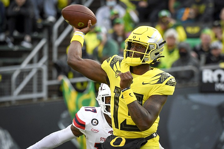 Oregon quarterback Anthony Brown (13) passes during the second quarter of an NCAA game against Stony Brook Saturday, Sept. 18, 2021, in Eugene, Ore. (Andy Nelson/AP)