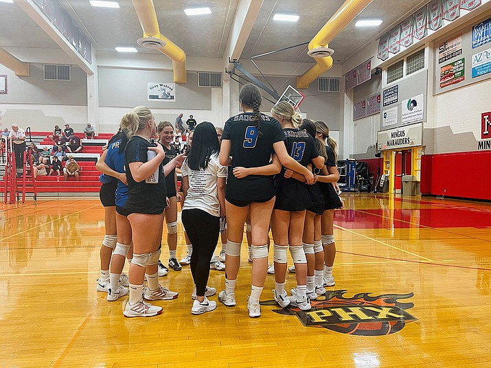 Prescott volleyball huddles up during a match against Mingus on Thursday, Sept. 23, 2021, in Cottonwood. The Badgers defeated the Marauders 3-1. (Prescott volleyball/Courtesy)