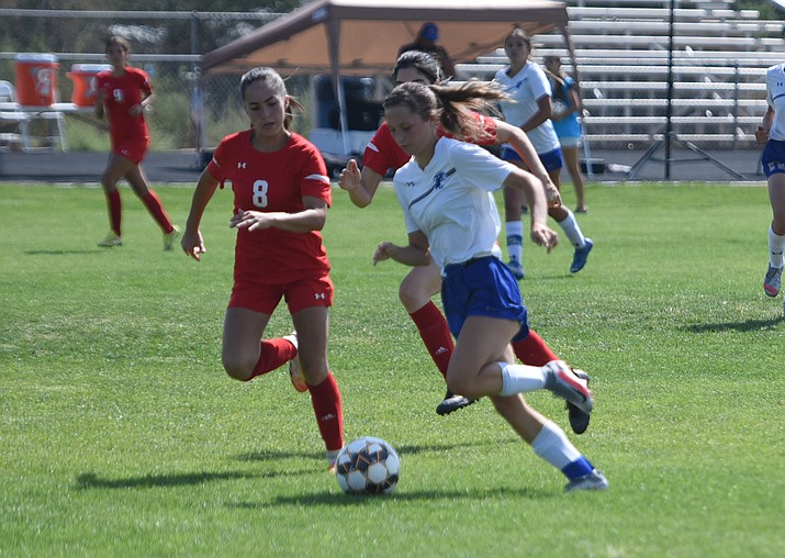 Chino Valley girls soccer midfielder Madison Foster dribbles past defenders during a game against St. Johns in the Cougar Cup tournament on Friday, Sept. 24, 2021, in Chino Valley. (Jesse Bertel/Courier)