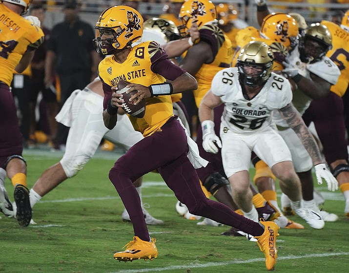 Arizona State quarterback Jayden Daniels (5) runs for a first down against Colorado State's defense during the first half of an NCAA game Saturday, Sept 25, 2021, in Tempe. (Darryl Webb/AP)