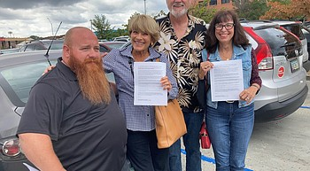 Yavapai Rising delivers petition to YRMC officials in Prescott to protest Nov. 1 vaccine mandate photo