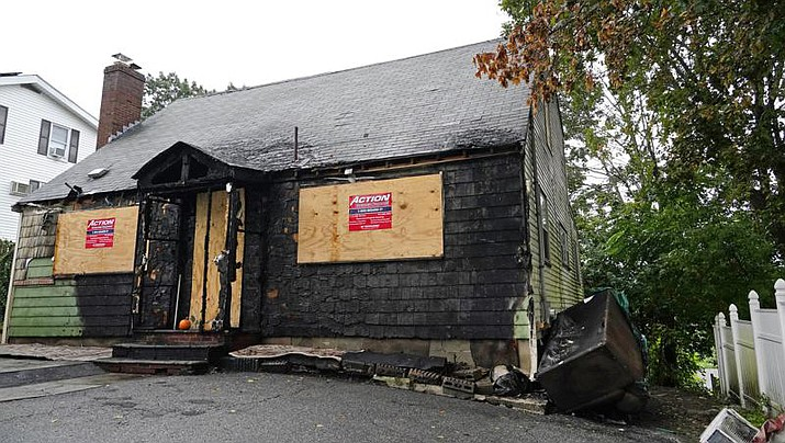A home that was seriously damaged by fire is seen, Tuesday, Sept. 28, 2021, in Melrose, Mass. WBZ-TV reported that the $399,000 asking price for the home in Melrose, a suburb of Boston, is evidence of how hot the housing market is in the state. (Elise Amendola/AP)
