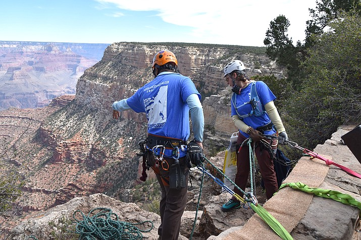 Volunteers with Arizona Mountaineering Club collect trash on the South Rim of Grand Canyon National Park Sept. 25. (Photo/NPS)