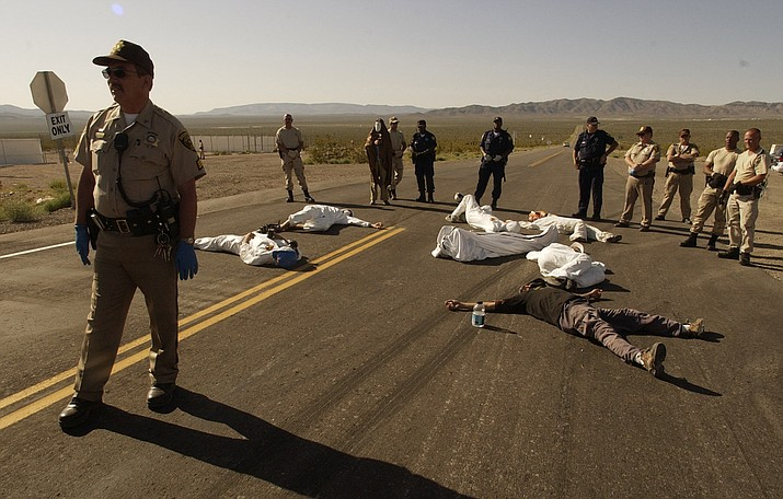 Protesters lie on the pavement opposed to the proposed Yucca Mountain nuclear storage facility and weapons testing after crossing the line into the Nevada Test Site at Mercury, Nevada, and were arrested for trespassing about 70 miles north of Las Vegas in 2003. Advocates have been working to bring awareness to the lingering effects of nuclear fallout on the Navajo Nation and in New Mexico. (AP Photo/Joe Cavaretta)