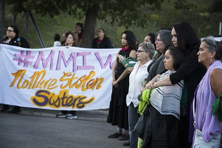In this Aug. 29, 2017, file photo Nicole Matthews, second from right, of Minneapolis and her daughter Kiora Burgess-Matthews, attend a prayer circle for Savanna LaFontaine-Greywind at the Ramsey County Medical Examiner's office in St. Paul, Minnesota. (Leila Navidi/Star Tribune via AP, File)
