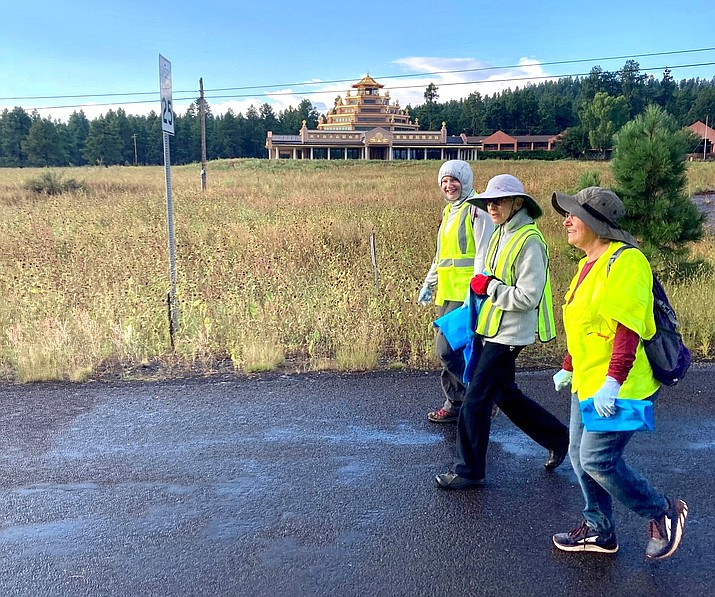On Sept. 18, residents and friends of the International Kadampa Retreat Center Grand Canyon joined in an annual highway clean up. Despite the rain, eleven volunteers collected 30 bags of trash over a one mile stretch of highway.  (Photos/International Kadampa Retreat Center)