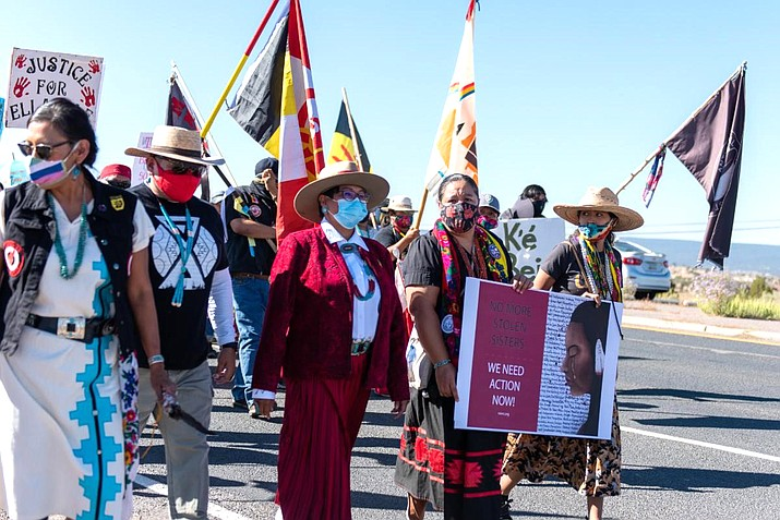 Council Delegate Eugenia Charles-Newton and Council Delegate Amber Kanazbah Crotty lead the Diné Sáanii for Justice marchers to the Navajo Nation Capitol. (Photo/Navajo Nation)