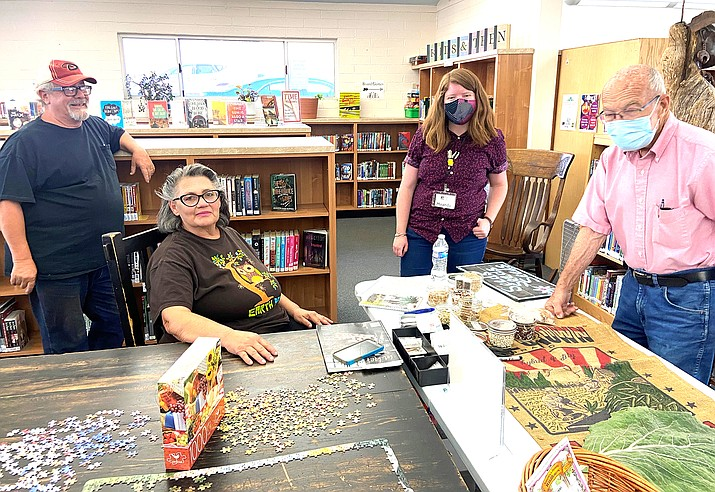 Williams resident Charlene Karon meets with others for a seed exchange at Williams Public Library Sept. 21. (Wendy Howell/WGCN)