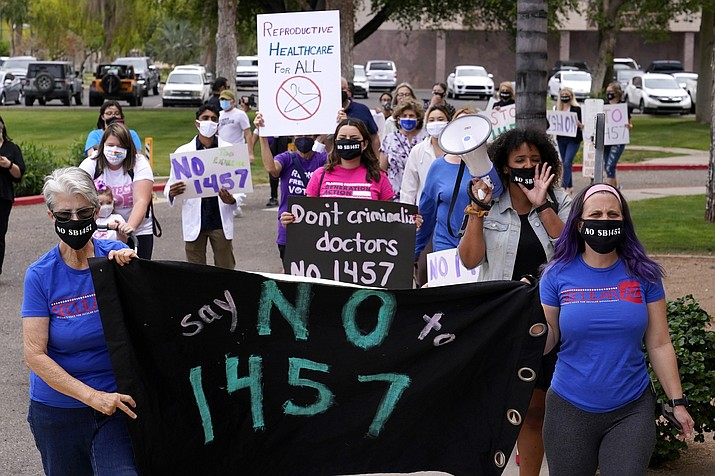 A number of Arizona reproductive rights groups march against the latest abortion bill April 26, 2021, in Phoenix. A federal judge late Tuesday, Sept. 28, blocked Arizona from making criminals out of doctors who perform abortions knowing the woman's reason is a genetic fetal defect. (Ross D. Franklin/AP, file)