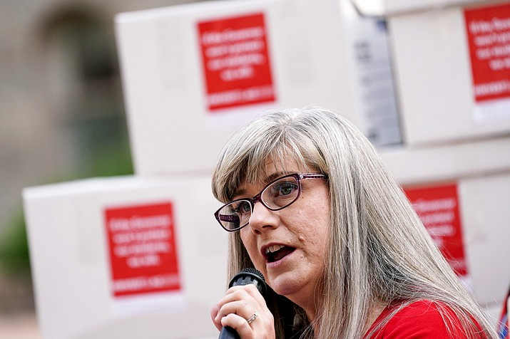 Education advocate Rebeca Gas speaks outside the State Capitol where members of the Invest in Arizona Coalition delivered signatures to the Arizona Secretary of State, Tuesday, Sept. 28, 2021, in Phoenix. The group was delivering boxes of signatures in an effort to stop income tax cuts passed by the Arizona Legislature earlier this year and a series of election law changes. (Matt York/AP)