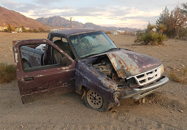 A Dolan Springs man was arrested, his sister was injured and his truck sustained heavy damage in a one-vehicle crash on Sunday, Sept. 26. (MCSO photo)