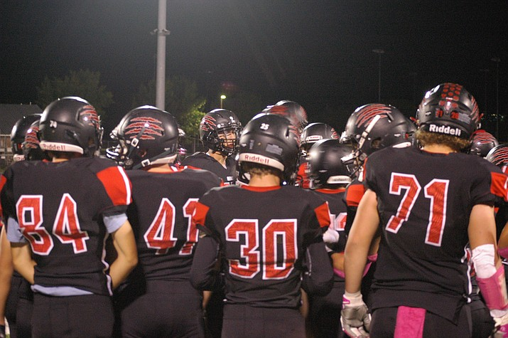 Bradshaw Mountain football gets into a huddle during a game against Mingus on Friday, Oct. 1, 2021, at Bob Pavlich Field in Prescott Valley. The Bears defeated the Marauders 57-45. (Doug Cook/Courier)