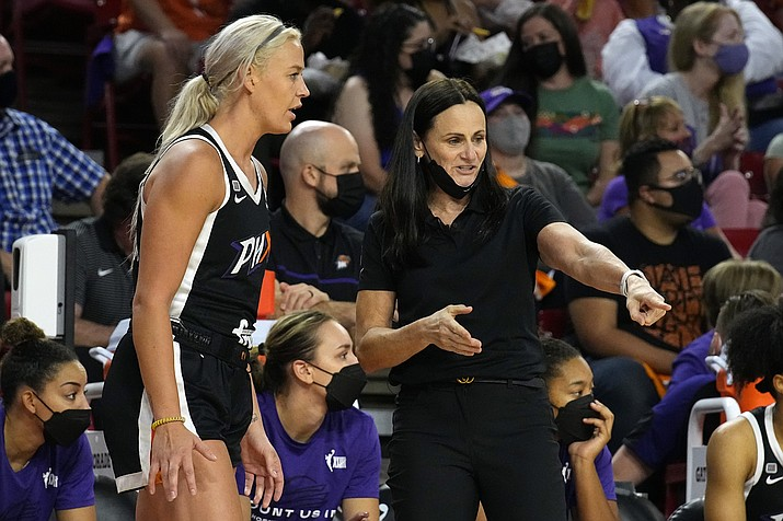 Phoenix Mercury guard Sophie Cunningham (9) talks to head coach Sandy Brondello during the first half of a game against the Las Vegas Aces, Sunday, Oct. 3, 2021, in Phoenix. (Rick Scuteri/AP)