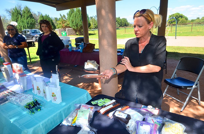 Cori Herwick, a harm-reduction outreach worker with Sonoran Prevention Works, was at Windmill Park in Cornville on Saturday, Oct. 2, 2021, talking to people about overdose and HIV prevention. She handed a Narcan kit to a woman interested in the kits. (Vyto Starinskas/Independent)