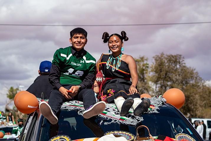 Homecoming Royalty Papsiya Lomayestewa and Kathleen Honahnie enjoy a ride through town. (Gilbert Honanie/NHO)
