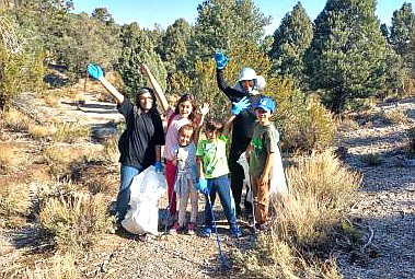 Kaibab National Forest partners and Reyna Butler with the Public Lands Interpretive Association help at the volunteer clean-up day at Kaibab Lake in Williams. (Photos/KNF)