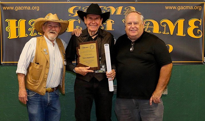 Greater Arizona Country Music Association Vice President Buffalo Rick Galeener, left, Tom Jepperson, middle, and GACMA radio deejay and station manager Rick West pose for a photo after Jepperson was inducted into the GACMA Hall of Fame on Sept. 26, 2021, in Phoenix. (Bill Tauson/Courtesy)