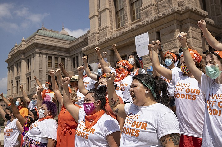 In this Sept. 1, 2021, file photo, women protest against the six-week abortion ban at the Capitol in Austin, Texas. A federal judge on Wednesday, Oct. 6 ordered Texas to suspend the most restrictive abortion law in the U.S., which since September has banned most abortions in the nation's second-most populous state. (Jay Janner/Austin American-Statesman via AP, File)