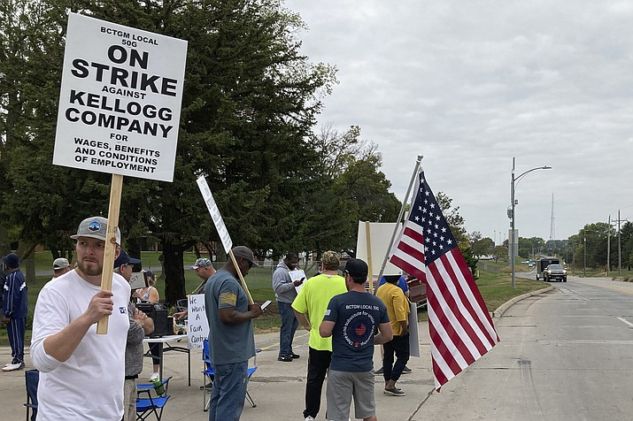 Workers from a Kellogg's cereal plant picket along the main rail lines leading into the facility on Wednesday, Oct. 6, 2021, in Omaha, Neb. Workers have gone on strike after a breakdown in contract talks with company management. (Grant Schulte/AP).