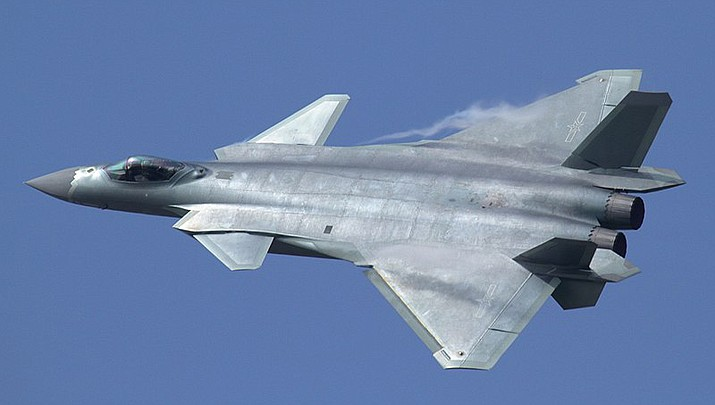 China's air force has been flying numerous sorties near Taiwan, an island nation that once part of mainland China. A Chinese Chengdu J-20 fighter jet is pictured. (Photo by Alert5, cc-by-sa-4.0, https://bit.ly/3BjKQfp)