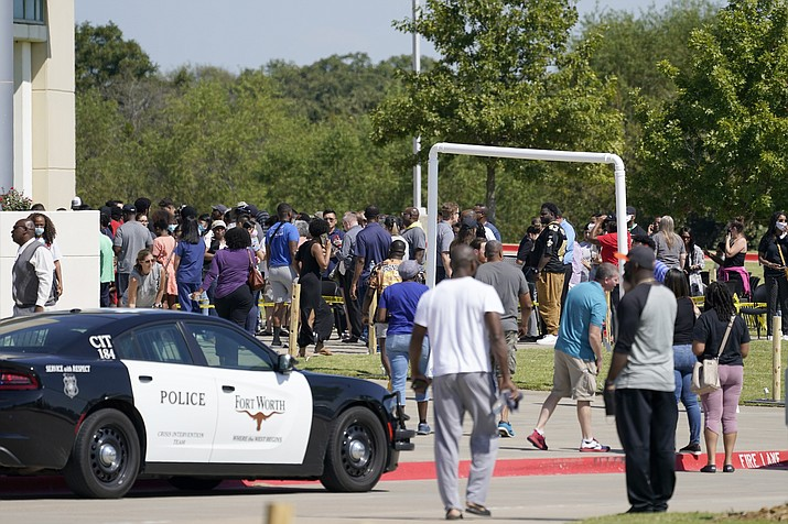 Families stand outside the Mansfield ISD Center for the Performing Arts waiting to be reunited with their children, Wednesday, Oct. 6, 2021 in Mansfield, Texas, following a shooting at the Timberview High School in Arlington. (Tony Gutierrez/AP)