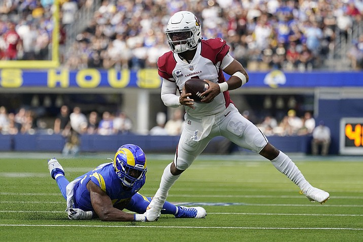 Arizona Cardinals quarterback Kyler Murray evades the tackle attempt from Los Angeles Rams linebacker Obo Okoronkwo during the first half in an NFL football game Sunday, Oct. 3, 2021, in Inglewood, Calif. (Ashley Landis/AP)